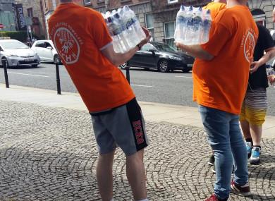 Volunteers provide water to homeless in Dublin