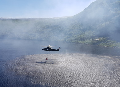 An Air Corps helicopter collecting water from Lower Lough Bray to help combat wildfires.