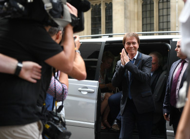 Cliff Richard arrives at the Rolls Building in London to hear the ruling of the dispute that he has with the BBC.