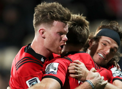 On course: Crusaders players celebrate a try against the Sharks.