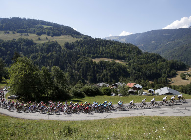 The pack climbs Col du Pre pass during the 11th stage of the Tour de France.