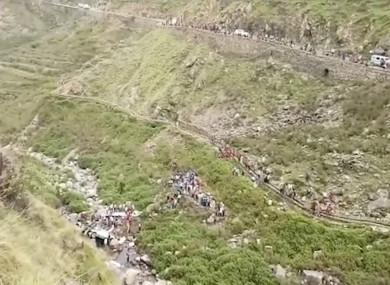This grab made from video provided by KK Productions, shows the area of a deadly bus accident in Uttarakhand's Paudi Garhwal district, northern India.