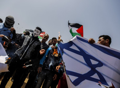 Protesters set fire to an Israeli flag bearing the picture of Israeli Defence Minister Avigdor Lieberman during clashes.