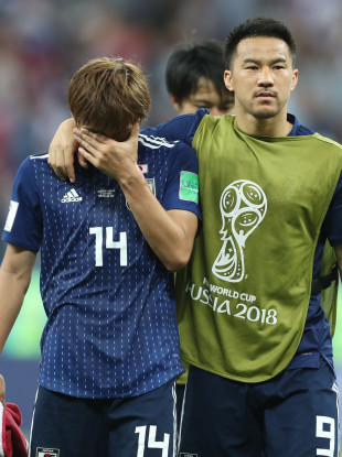 d19c00e462c Takashi Inui (L) of Japan reacts after the 2018 FIFA World Cup round of