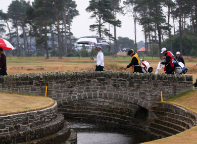 Rory McIlroy walks over the bridge on the 10th during day two of The Open Championship 2018 at Carnoustie.