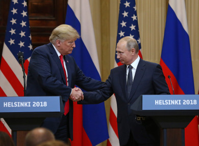 Donald Trump shakes hands with Vladimir Putin during a joint press conference at the Presidential Palace in Helsinki.
