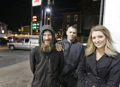Johnny Bobbitt Jr, left, Kate McClure, right, and McClure's boyfriend Mark D'Amico pose at a Citgo station in Philadelphia.