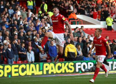 Murphy celebrates his late goal on Saturday at the City Ground.