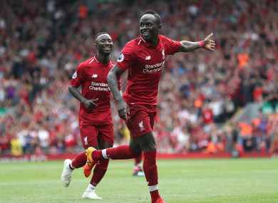 Mane celebrates scoring Liverpool's third goal.