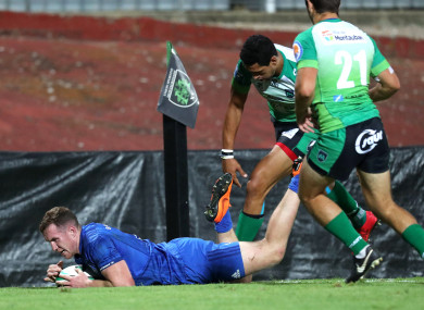 Rory O'Loughlin dives over for Leinster's first try.