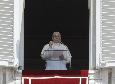 Pope Francis delivers his message during the Angelus noon prayer in St Peter's Square at the Vatican.
