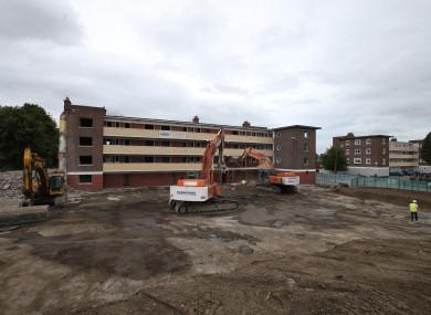 Residents watch as Demolition crews start to demolish final block in St Teresa's Gardens in Dublin in 2016