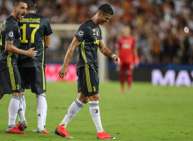 Cristiano Ronaldo walks off after receiving a red card.
