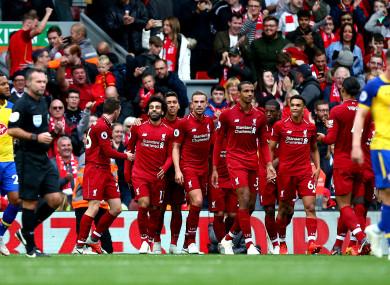 Mohamed Salah celebrates scoring Liverpool's third at Anfield.