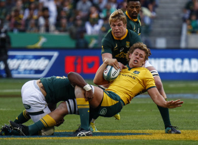 Ned Hanigan is tackled by Pieter-Steph du Toit in Port Elizabeth.