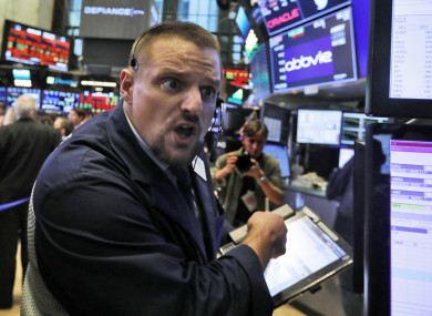 Trader Michael Milano on the floor of the New York Stock Exchange.