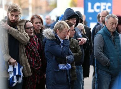 Supporters gather to pay tribute at Leicester City Foootbal Club.