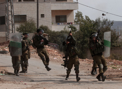 Israeli soldiers fire tear gas canisters at Palestinian protesters during clashes after a protest against the expanding of Jewish settlements in Kufr Qadoom village near the West Bank