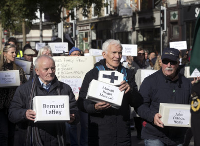 People march carrying boxes representing the victims of those who died in Tuam during a silent procession for the Tuam Babies from Garden of Remembrance this month.