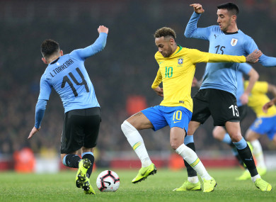 Brazil's Neymar (centre) battles for the ball with Uruguay's Lucas Torreira (left) and Matias Vecino (right).