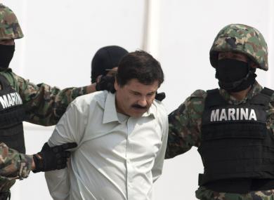 Joaquin 'El Chapo' Guzman being escorted by Mexican Marines in 2014.