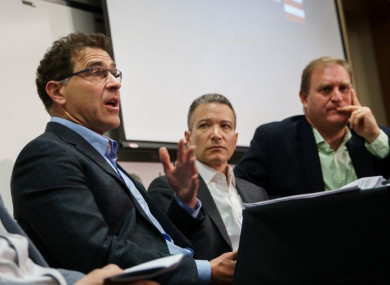 Elliot Schrage (far left) pictured at a conference at Stanford University in May.