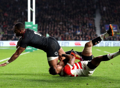 England's Joe Cokanasiga scores his side's third try of the match against Japan.