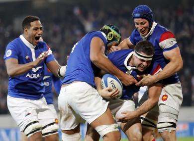 France celebrate Guilhem Guirado's try.