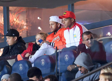 Neymar and Mbappe: watched Saturday's win from the stands.