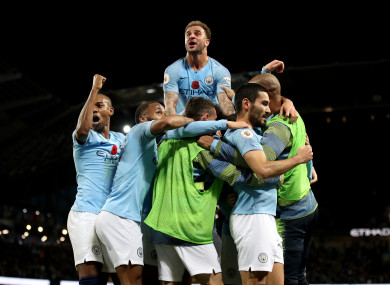 Man City players celebrate at the Emirates during their win over United.