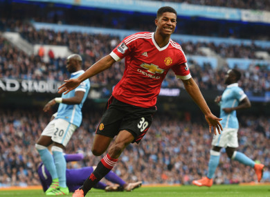 Rashford celebrates scoring against Manchester City.