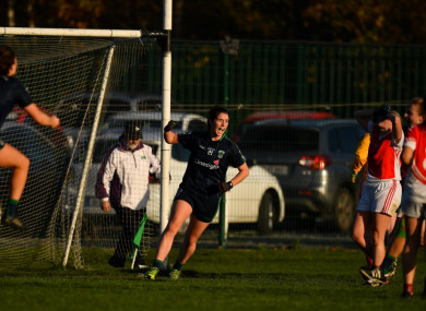 Róisín McGovern of Foxrock-Cabinteely, centre, celebrates after scoring her side's last-minute winning goal.