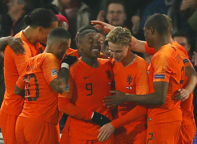 Netherlands players celebrate scoring.