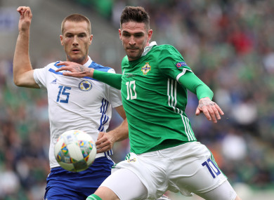 Lafferty in action against Bosnia and Herzegovina's Toni Sunjic.