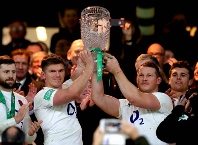 Farrell and Hartley lift The Cook Cup.