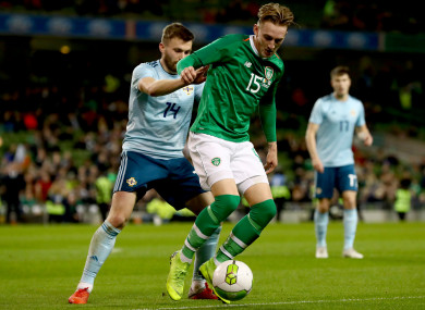 Ronan Curtis under pressure from Northern Ireland's Stuart Dallas during his Republic of Ireland debut.