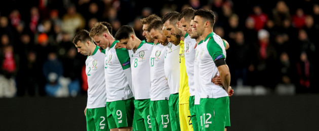 The Ireland team observe a silence ahead of the game with Denmark in tribute to 30 year-old David Clerkin.