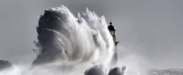 Waves crash over Seaham Lighthouse near Durham, England.