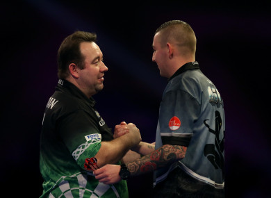 Brendan Dolan (left) is consoled by Nathan Aspinall.