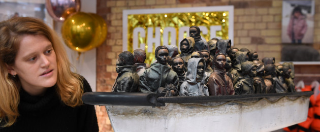 Banksy's 'Dream Boat' sculpture is on display in the  Help Refugees shop in London, where visitors can enter a competition to win the sculpture.