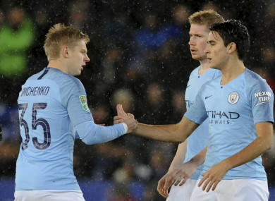 Manchester City's Oleksandr Zinchenko, left, and teammate Eric Garcia, shake hands just prior to kick-off.