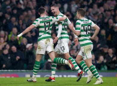 Ryan Christie (left) celebrates scoring his side's fourth goal.