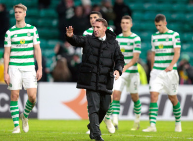 Celtic manager Brendan Rodgers along with some of his players after the game.