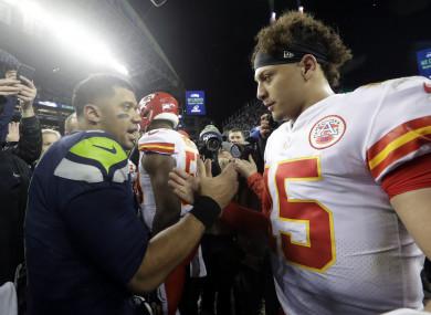 Seattle Seahawks quarterback Russell Wilson, left, greets Kansas City Chiefs quarterback Patrick Mahomes.