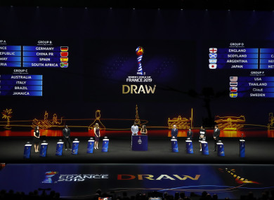 Conductors and moderators stand on the stage during the women's soccer World Cup France 2019 draw, in Boulogne-Billancourt.