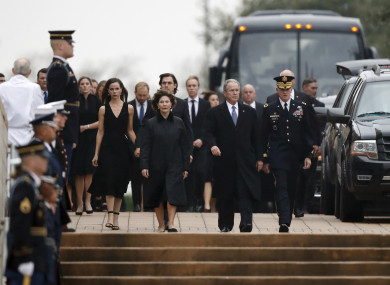 Former President George W. Bush walks with former first lady Laura Bush and their daughter Barbara Pierce Bush as the flag-draped casket of former President George H.W. Bush arrives