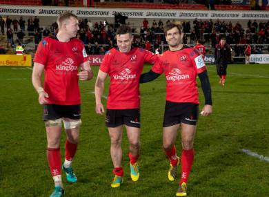 Kieran Treadwell, John Cooney and Louis Ludik celebrate the win over the Scarlets.