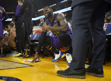 LeBron James injured in Lakers Christmas Day rout of defending champion  Warriors df68a00c3