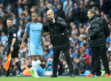 Pep Guardiola and Raheem Sterling (file pic).