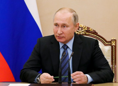 Russian President Vladimir Putin chairs a Security Council meeting in the Kremlin in Moscow on Friday.